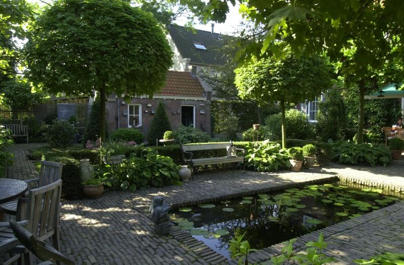 Landelijke tuin projecten oxalis for Landelijke stadstuin